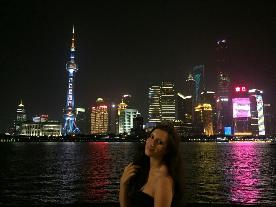 Laura Minafo' and a view of the Shanghai skyline